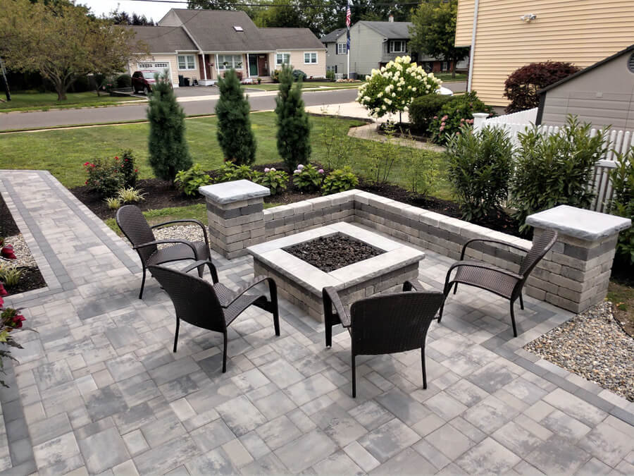 A firepit surrounded by chairs.