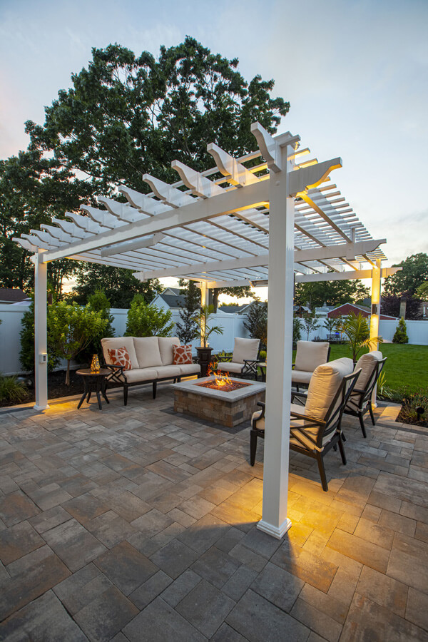 An outdoor living area with chairs and a firepit.